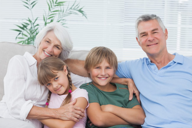 Portrait of grandparents on couch with grandkids